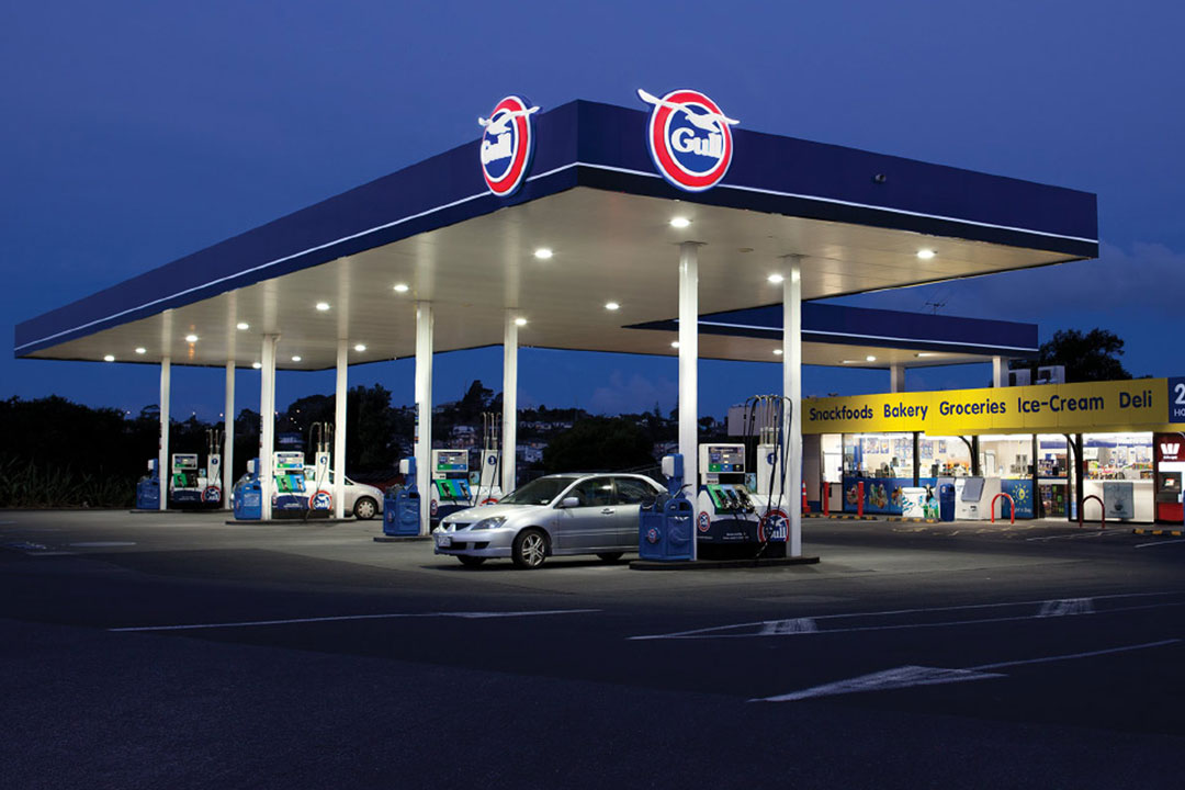 Gull petrol station at night featuring 3D logo signs and fascia panels produced and installed by Xtream signs
